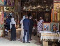A priest reads a prayer at the wedding ceremony held in the Orthodox tradition in Greek Orthodox monastery of the twelve apostles stock photos