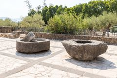 Stones from the oil press in the courtyard of Tabgha - the Catholic Church Multiplication of bread and fish. Tiberias, Israel, September 10, 2018 : Stones from stock photography