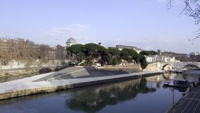 Tiberina Island. The island Tiberina in the Tiber river in Rome with the bridge Stock Photography