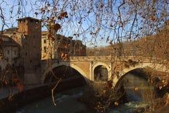 Tiberina Island Isola Tiberina on the river Tiber in Rome, Italy in autumn.  stock photo