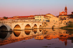 Tiberius' Bridge at sunset. Rimini, Italy. Historical roman Tiberius' bridge over Marecchia river, Rimini, Italy stock image