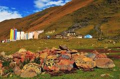Tibet Armani stone carving. With Tibetan prayer flags Royalty Free Stock Photography