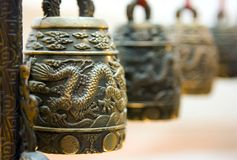 Tibet bells. Four antique tibet bells with illustrated dragon royalty free stock image