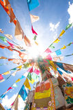 Tibet flags. Colorful prayer flag in tibet under blue sky and white cloud royalty free stock images