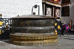 Tibet, Lhasa, China, June, 02, 2018. Large bronze bowl at the walls of the ancient Buddhist monastery jokhang inn Lhasa. Tibet, Lhasa, China. Large bronze bowl stock photos