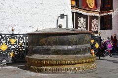 Tibet, Lhasa, China, June, 02, 2018. Large bronze bowl at the walls of the ancient Buddhist monastery jokhang in Lhasa. Tibet, Lhasa, China. Large bronze bowl at stock photos