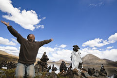 Tibet: man praying with open arms Royalty Free Stock Images