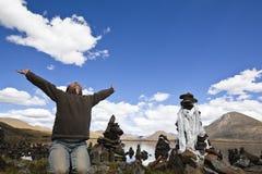 Tibet: man praying with open arms Stock Photo