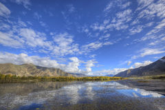Tibet: mountain, lake and treeline stock photo