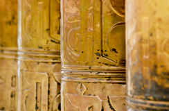 Tibet - Prayer wheels. Row of prayer wheels at Samye monastery, Tibet Royalty Free Stock Images