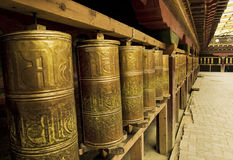 Tibet prayer wheels. Meny tibet prayer wheels in this picture Royalty Free Stock Images