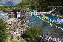 Tibet: rope bridge with prayer flags Royalty Free Stock Photo