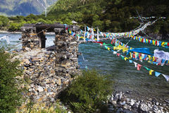 Tibet: Rope Bridge With Prayer Flags Royalty Free Stock Photo
