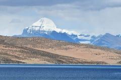 Tibet. Sacred lake Manasarovar and southern face of Kailas.  royalty free stock photography