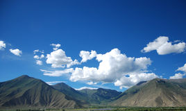 Tibet scenery. The most common Tibet scenery, blue sky, white clouds, the castle peak Royalty Free Stock Photo