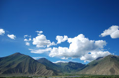 Tibet scenery. The most common Tibet scenery, blue sky, white clouds, the castle peak Stock Photo
