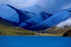 Tibet snow mountain lake Stock Photography
