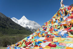 Tibet snow mountain with Mani Dui. In China Royalty Free Stock Photography