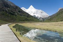 Tibet snow mountain with river Stock Photos