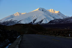 Tibet Snow mountain road Stock Photography