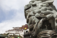 Tibet: stone lion and potala palace Royalty Free Stock Images
