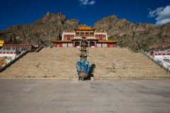 Tibet temple with mountain and square Royalty Free Stock Photos