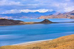 Tibet Yamdrok lake snow mountain lake Yangzhuoyongcuo. Yamdrok lake(Yangzhuoyongcuo) 2016 in Tibet, the sunset, the snow-capped mountains, clear lakes, the sheep Royalty Free Stock Photography