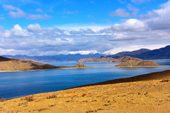 Tibet Yamdrok lake snow mountain lake Yangzhuoyongcuo. Yamdrok lake(Yangzhuoyongcuo) 2016 in Tibet, the sunset, the snow-capped mountains, clear lakes, the sheep Royalty Free Stock Image