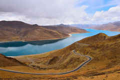 Tibet Yamdrok lake snow mountain road Stock Image