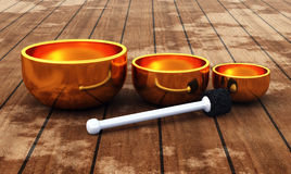 Tibet - ZEN Singing Bowl 01. 3 3D golden singing Bowls on wood stock illustration
