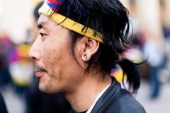 Tibetan. Wearing an earring Free Tibet. Paris, March 10th, 2012 Stock Photography