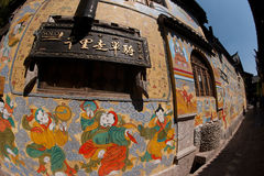 Tibetan art murals on building wall in Dayan old town. Stock Image
