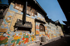 Tibetan art murals on building wall in Dayan old town. Royalty Free Stock Photography
