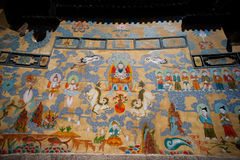 Tibetan art murals on building wall in Dayan old town. Stock Photo