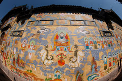 Tibetan art murals on building wall in Dayan old town. Stock Photos