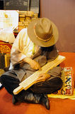 Tibetan artisan carving a sutra printing block Stock Photos