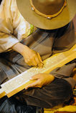 Tibetan artisan carving a sutra printing block Royalty Free Stock Image