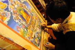 Tibetan artisan  painting tangka Stock Images
