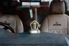 Tibetan automatic prayer wheel in the front of tourist car at Lachung in winter. North Sikkim, India Stock Photography