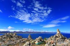 Mani piles beside Namtso Lake, Tibet royalty free stock image