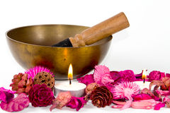 Tibetan bowl, flowers and candles. Stock Images