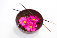 Tibetan bowl, incense sticks and flowers in oil. royalty free stock images
