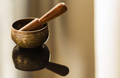 Tibetan bowl. And its reflection Royalty Free Stock Image