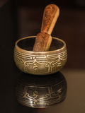 Tibetan bowl. With its reflection and wood Royalty Free Stock Photography