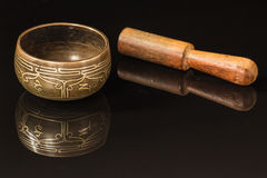 Tibetan bowl. With lotus flower on black reflection Stock Image