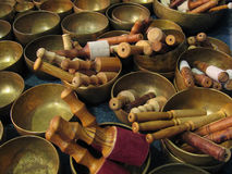 Tibetan bowls with sticks royalty free stock image
