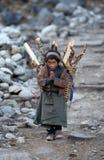 Tibetan boy with basket royalty free stock photography