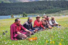 Some Tibetans chatting, sitting on the prairie. At Batang country, tibet Stock Photography