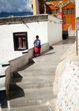 Tibetan boys, novice Buddhist monks. India. THIKSEY, INDIA - SEPTEMBER 13: Unidentified tibetan boy, novice monk, student of Buddhist school at Thiksey monastery royalty free stock images