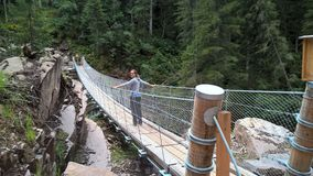 Tibetan bridge in val di fiemme at la Scofa Royalty Free Stock Photo